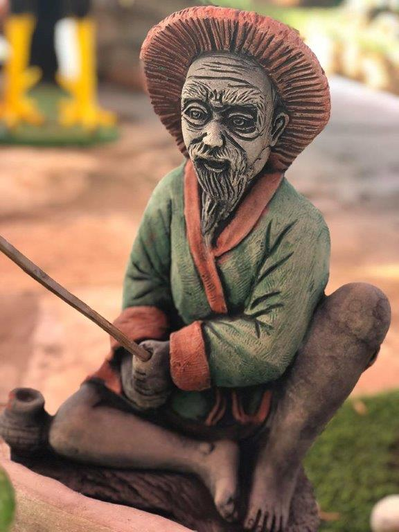 פסל בובה לגינה